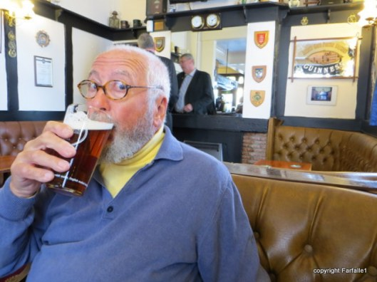 Louis drinks Doombar in pub